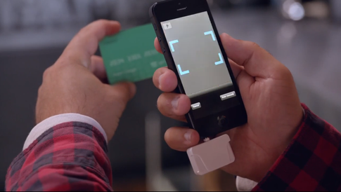 The small white device connected to the iPhone is where you swipe in cards
